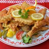 Fillets of Carp on a Wooden Plate with Garnish